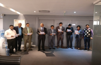 Officers of the Indian Embassy undertaking a pledge to create a New India, themed Sankalp se Siddhi (Attainment through Resolve)